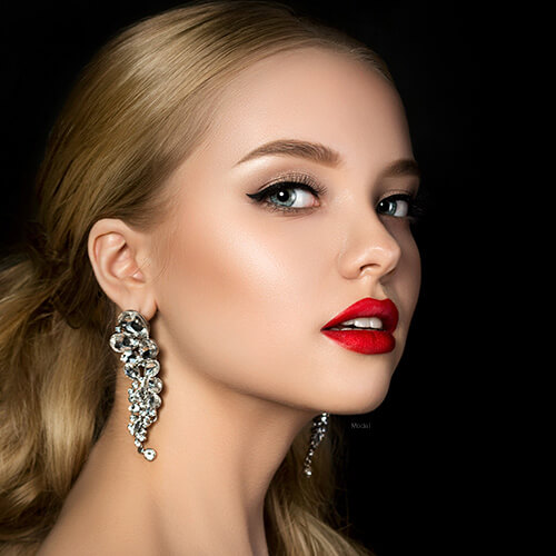 Woman with red lipstick and nice earings