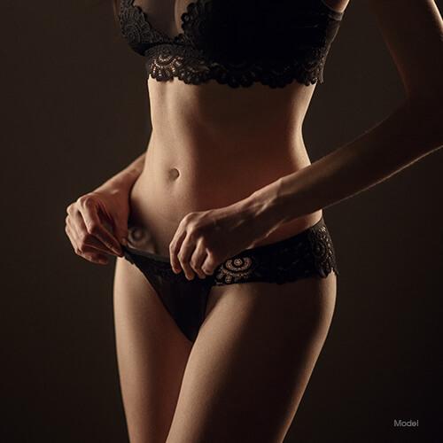 Woman adjusting her underwear