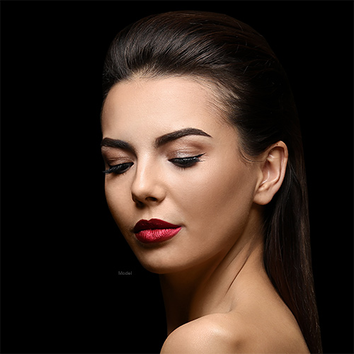 Woman with red lip stick closing her eyes