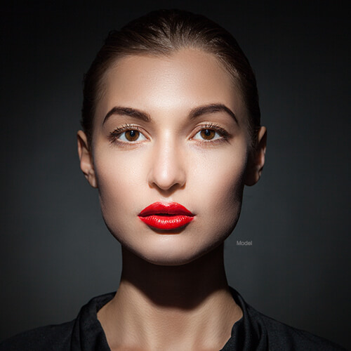 Woman with bright red lipstick