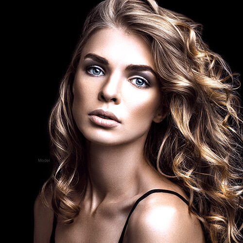 Woman with wavy blonde hair