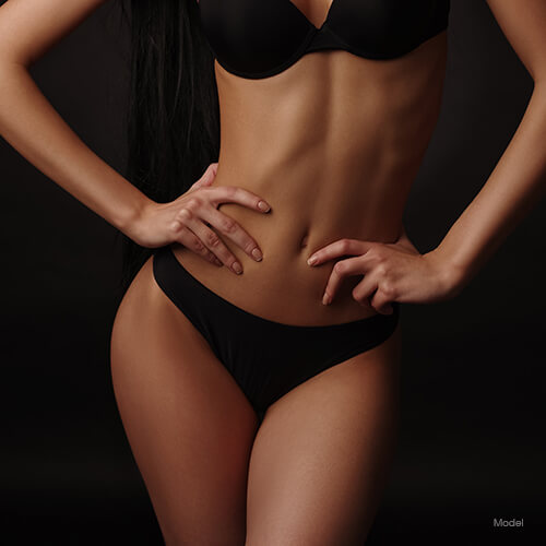 Fit woman with hands on her hips